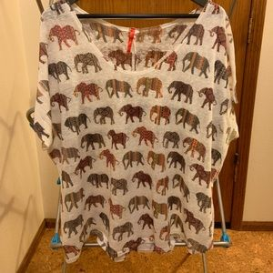 Cream colored lightweight sweater with elephants